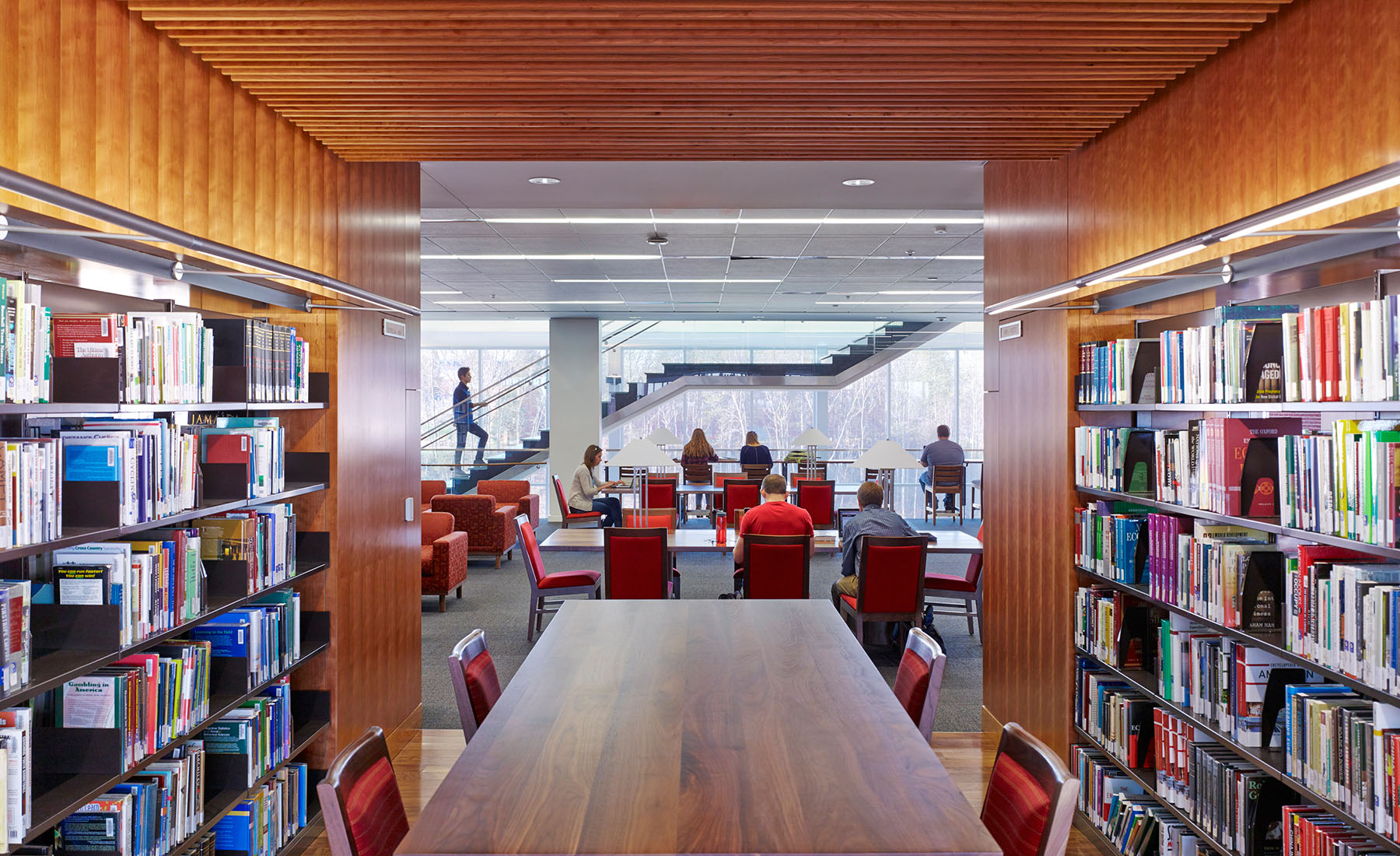 Compared to prototypical libraries of the past, Liberty's new flagship library reverses the notion of book storage as the central motive of a library's design in favor of a user-centric layout that places student activity in the foreground.