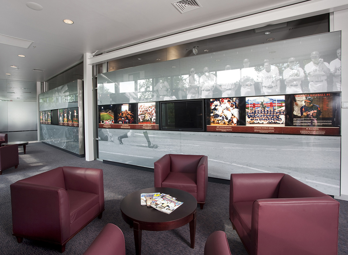 At a more interactive level, the mural walls hold a continuous band of digital and graphic media depicting the most recent timeline of program highlights and relevant data about the program's history for recruits and players to explore.