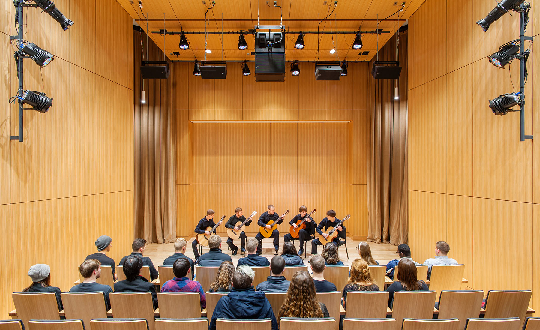 Students and instructors from a wide range of undergraduate and graduate degree programs meet and collaborate in a range of learning spaces, including: individual practice modules, small group practice rooms, teaching studios, commons rooms, traditional classrooms, and choral, percussion, and band practice rooms – each painstakingly designed to produce the perfect physical space for musical performance.