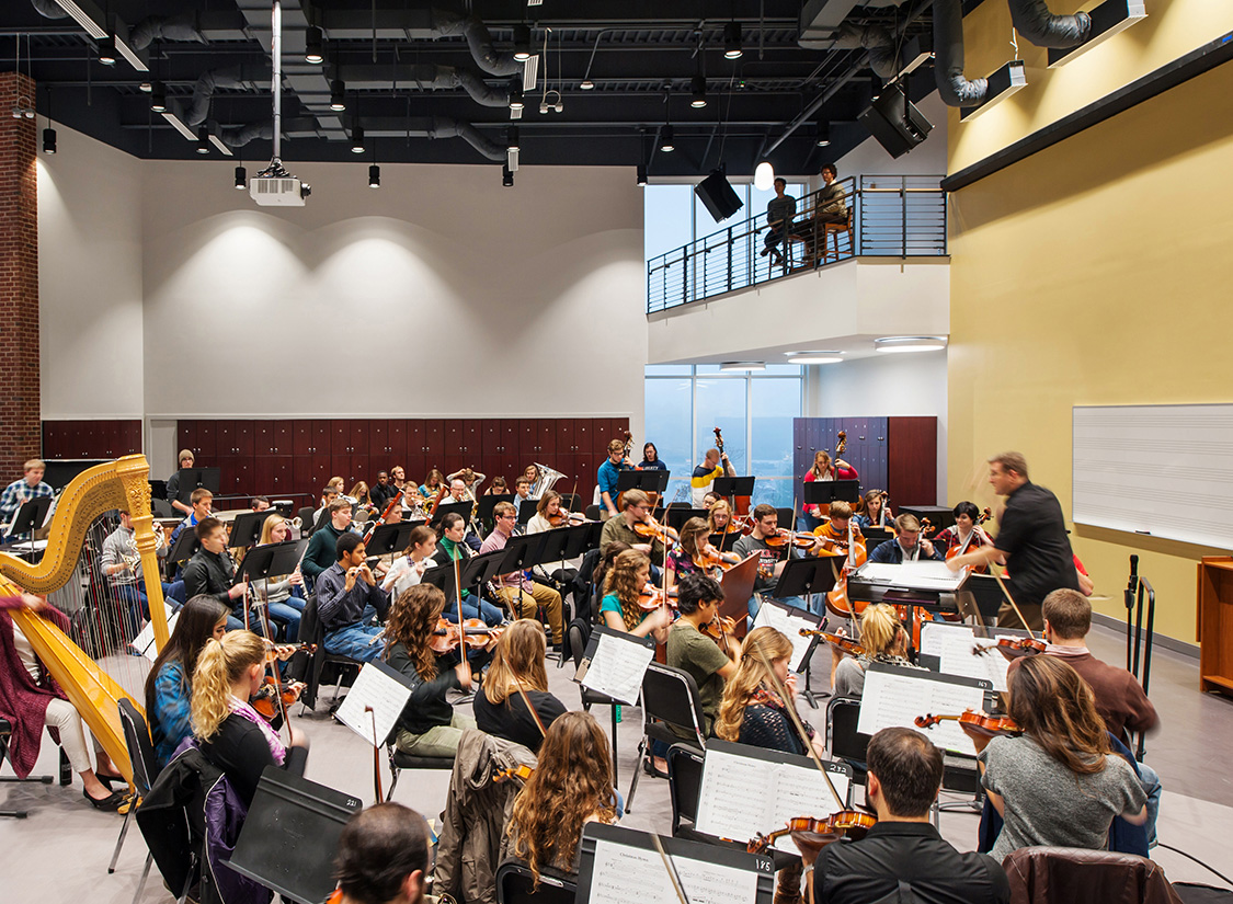 Anchoring the academic wings of the School of Music are the 250 seat band room and the stepped 150 seat choir recital room – featuring carefully-tuned spaces for practice and performance.