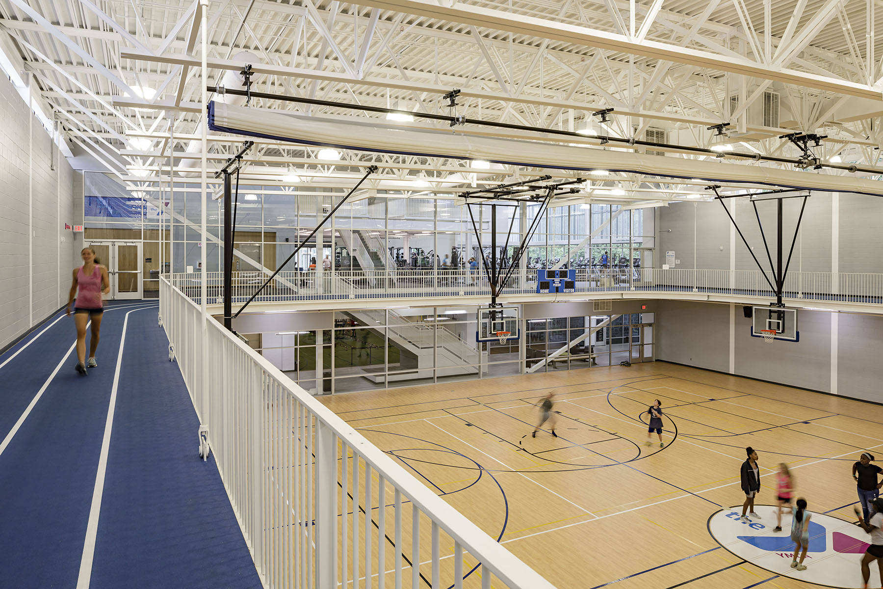 double gymnasium with multipurpose stage and elevated running track
