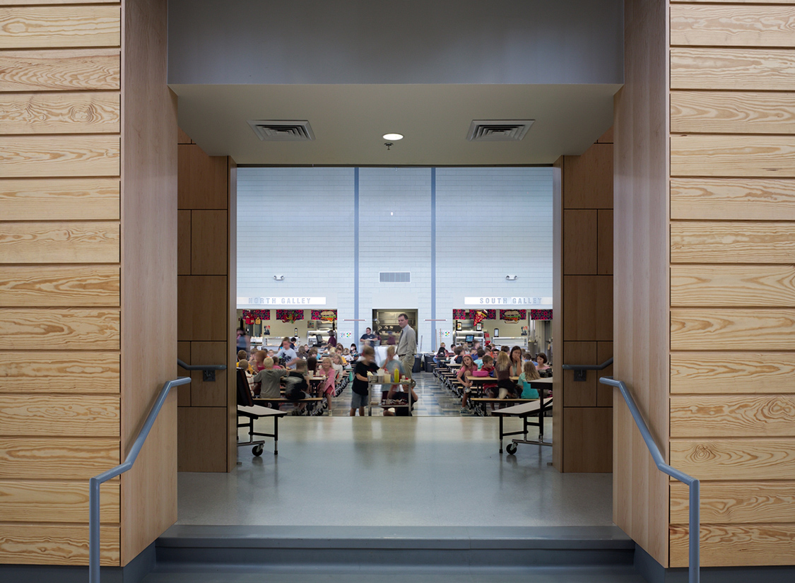 "Public and community use spaces (media center, cafeteria / commons, and gymnasium) are grouped together and separated from the main body of the school by the administration. The educational spaces are organized around ""grade houses"", smaller communities of 225 students."