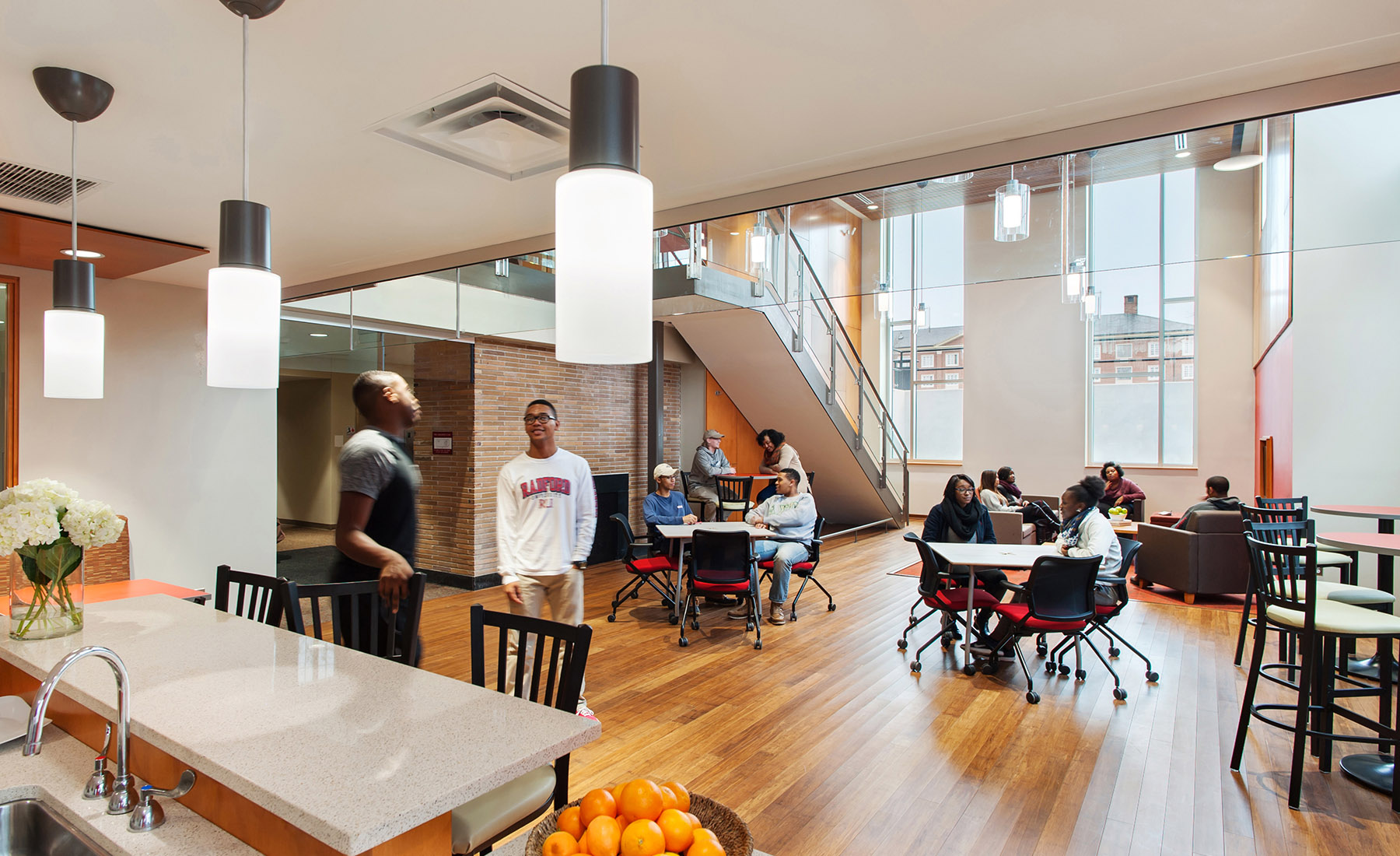 By removing an existing floor, VMDO designed a new two-story lounge space at the north end of each building. The new commons creates a remarkably open gathering space that is at once open and light-filled as well as private and removed.