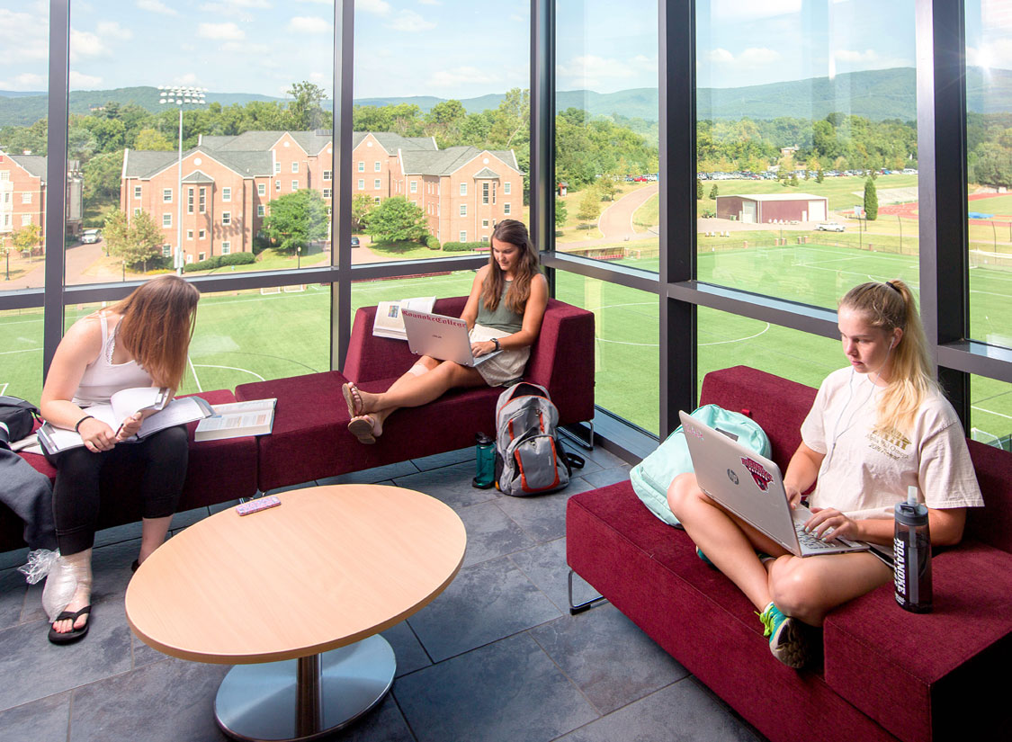 Meeting / study spaces featuring transparent details that overlook the campus and mountain setting beyond.