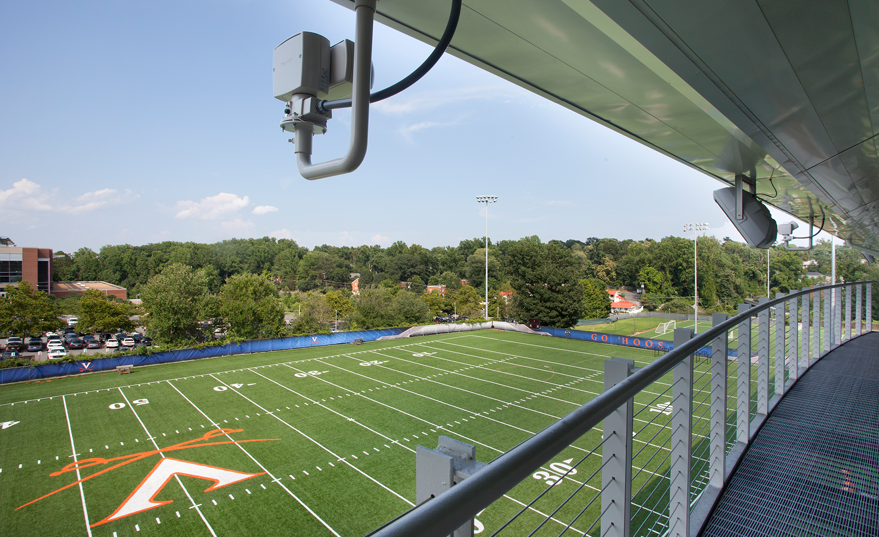 The single story, open volume facility features a small central platform for viewing by coaches and filming.
